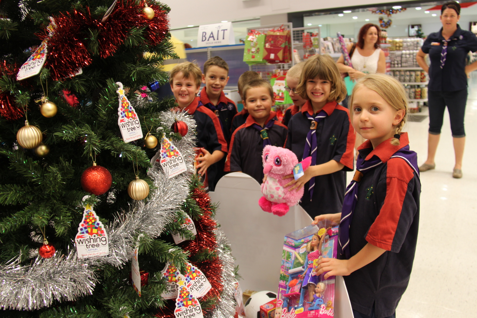 scout group is celebrating the true meaning of christmas time after helping their six and seven year old children give gifts to those less fortunate